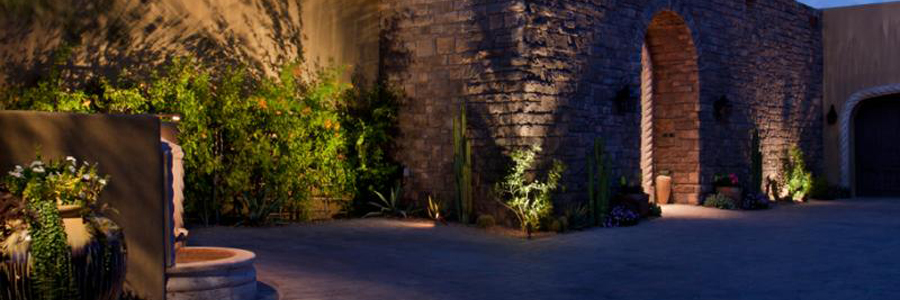 Landscape lighting showcasing a stone courtyard